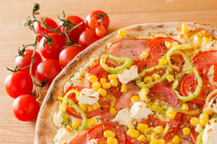 Pizza with paprika, feta, cherry tomato corn and ham - Top view Royalty Free Stock Photos