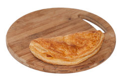 Pizza pastry half on the wooden board Stock Photo