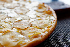 Pizza with pear and gorgonzola cheese Stock Photos