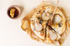 Pizza with pear and gorgonzola Stock Photos