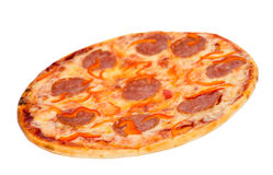 Pizza with peperoni. A pizza with peperoni and red paprika, clipping path stock images