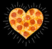 Pizza with peperoni of heart shape. Heart cut of pizza with peperoni and cheese stock image