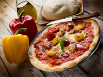 Pizza with pepper. And basil leaf Royalty Free Stock Images