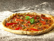 Pizza with pepper and basil Stock Image