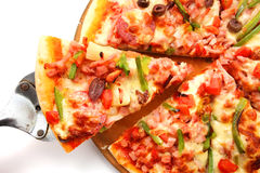Pizza with pepperoni, bell peppers, black olives Stock Images