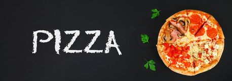 Pizza with pepperoni, champignons, tomato and cheese. Four tastes in one pizza. black chalkboard. Banner. Pizza with pepperoni, champignons, tomato and cheese Royalty Free Stock Image