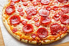 Pizza pepperoni with cheese and oregano royalty free stock image