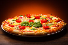 Pizza. Pepperoni - cheese, salami, vegetables royalty free stock photography