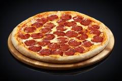 Pizza pepperoni, mozzarella, oregano Royalty Free Stock Image