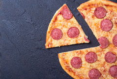 Pizza with pepperoni. New York style pizza with pepperoni, ham, olives, sausage & peppers Royalty Free Stock Image