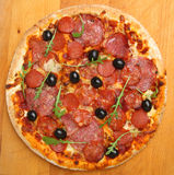 Pizza with Pepperoni Salami from Above Stock Photos