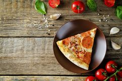 Pizza with pepperoni, tomato sauce and cheese stock photo