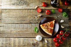 Pizza with pepperoni, tomato sauce and cheese stock photos