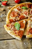 Pizza with pepperoni, tomato sauce and cheese stock image