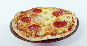 Pizza with pepperoni toppings. On white background stock footage