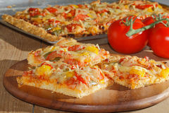 Pizza with peppers, tomatoes, ham, onion, cheese Stock Images
