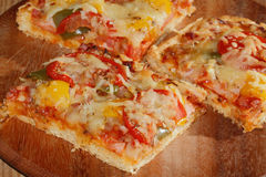 Pizza with peppers, tomatoes, ham, onion, cheese Royalty Free Stock Photography