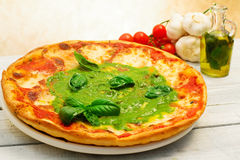 Pizza with pesto Royalty Free Stock Images