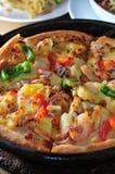 Pizza pie. In hot pan Stock Photos
