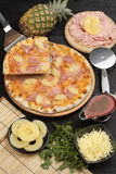 Pizza with pineapple and ham. Studio shot of pizza with pineapple and ham Stock Photo