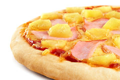 Pizza with pineapple and ham on white background. Royalty Free Stock Images