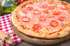 Pizza pizza with bacon and cherry Royalty Free Stock Image