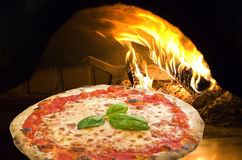 Pizza in a pizza oven royalty free stock photo