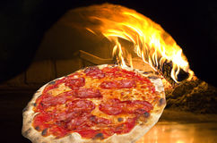 Pizza  in a pizza oven Royalty Free Stock Image
