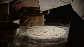 Pizza placing ingredients stock footage