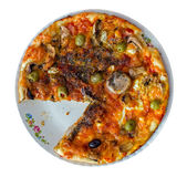 Pizza on plate with a slice off Royalty Free Stock Images