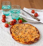 Pizza on a plate with tomatoes. And water Royalty Free Stock Photography