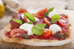 Pizza pomodoro, vegetarian and homemade  on white backgr Stock Photography