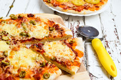 Pizza with potatoes and bacon and pizza with cheese Stock Photos
