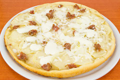 Pizza with potatoes and sausage in pieces Stock Image