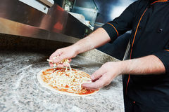 Pizza preparartion Royalty Free Stock Image