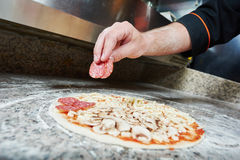 Pizza preparartion Stock Photography