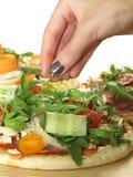 Pizza preparation Stock Image