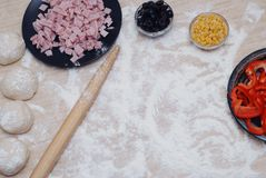 Pizza preparation on table Surrounded by ingredients. food photography. stock photos