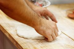 Pizza prepare dough hand topping Stock Image