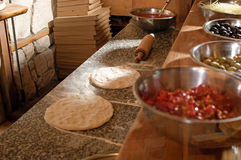 Pizza preparing. Photo of table with pizza royalty free stock photos