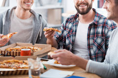 Pizza for productive work. Royalty Free Stock Photography