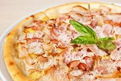 Pizza with prosciutto Stock Photo