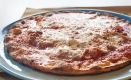 Pizza Prosciutto. Tasty pizza prosciutto on a plate Stock Image