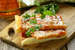 Pizza of puff pastry with tomato sauce Stock Images