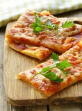 Pizza of puff pastry with tomato sauce Royalty Free Stock Photography