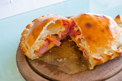 Pizza puff on the wood plate Royalty Free Stock Photo