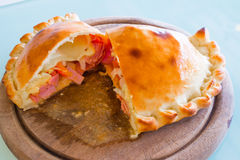 Pizza puff on the wood plate Royalty Free Stock Image