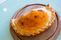 Pizza puff on the wood plate Stock Photos
