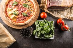 Pizza Quatro Stagioni four seasons traditional italian meal from stock photos