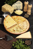 Pizza Quattro Formaggi. Studio shot of pizza Quattro Formaggi and ingredients Stock Image